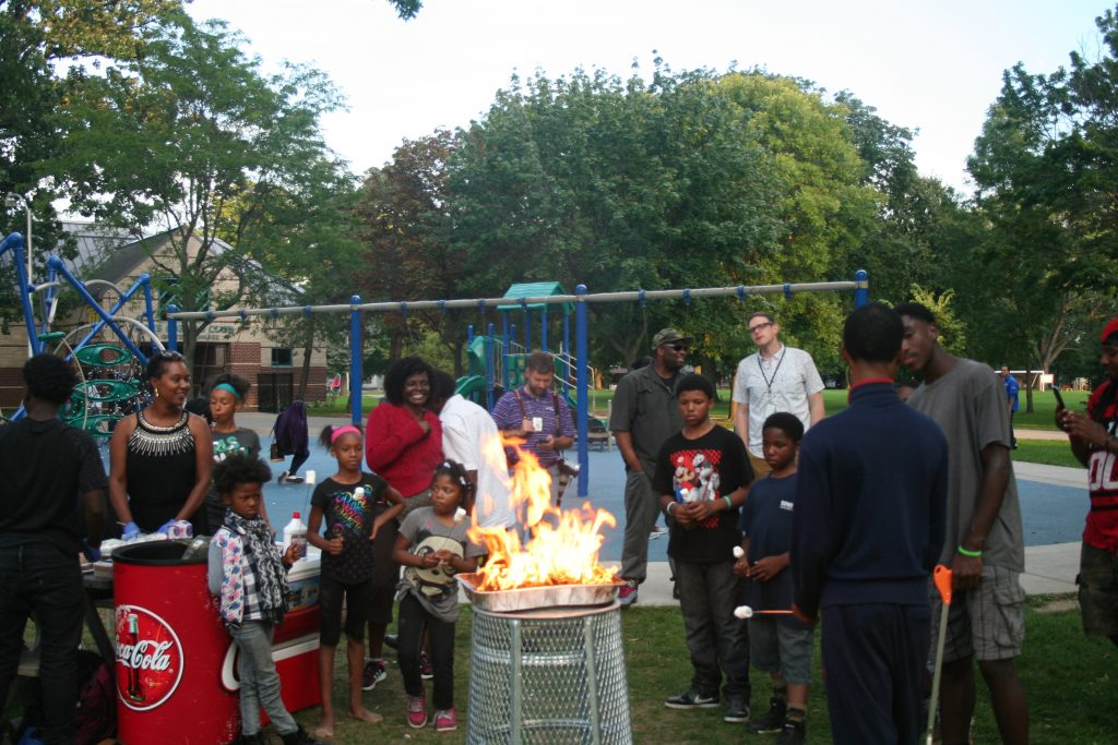 Residents, community members and elected officials gathered near the playground in Sherman Park in defiance of a weeks-long curfew. Photo by Jabril Faraj/NNS.