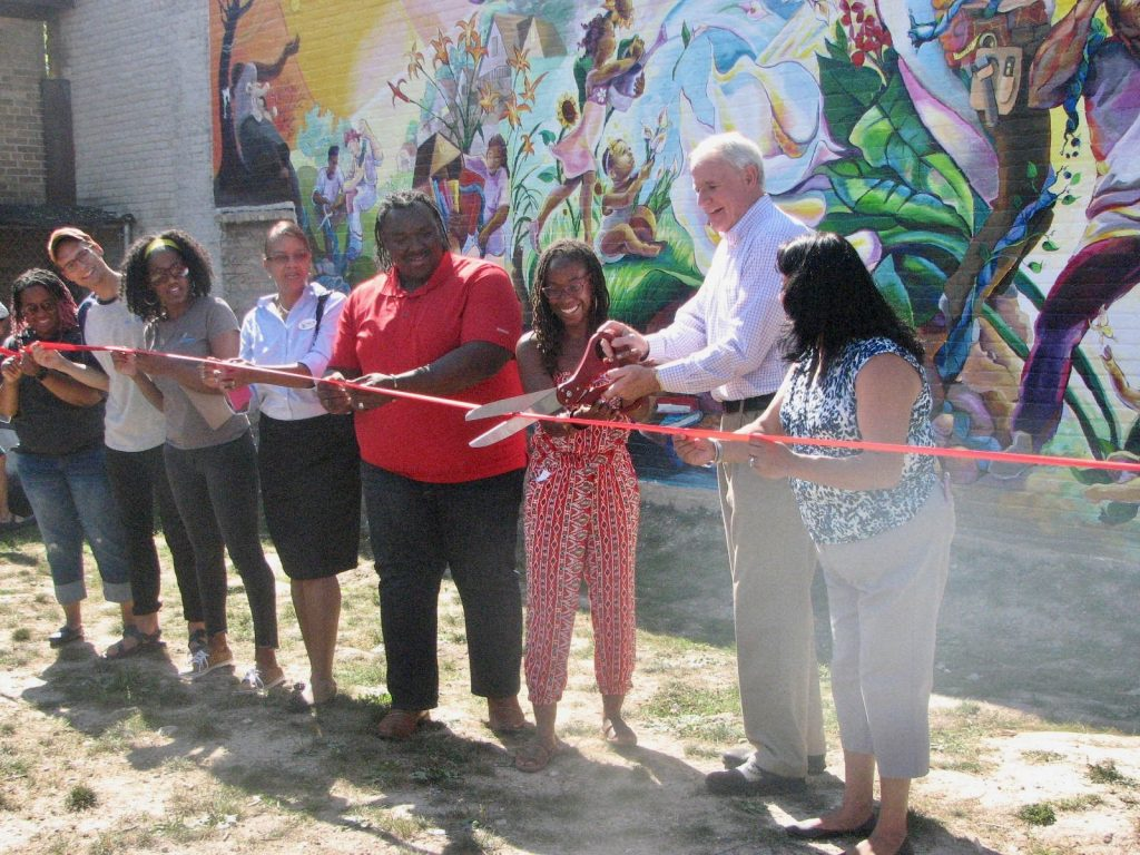 "The ceremonial ribbon cutting at the September 2017 completion of the ""Sherman Park Rising"" mural. Photo by Lydia Slattery/NNS."