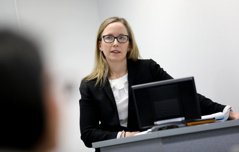 Erin Barbato is the director of the Immigrant Justice Clinic at the University of Wisconsin Law School. She teaches law students to represent immigrants in removal proceedings. Here, she leads a group of second-year law students at UW-Madison on Feb. 22, 2019. Barbato says even if marijuana were legal in Wisconsin, the fact that it remains illegal federally could mean negative consequences for immigrants who use it. Photo by Coburn Dukehart / Wisconsin Watch.