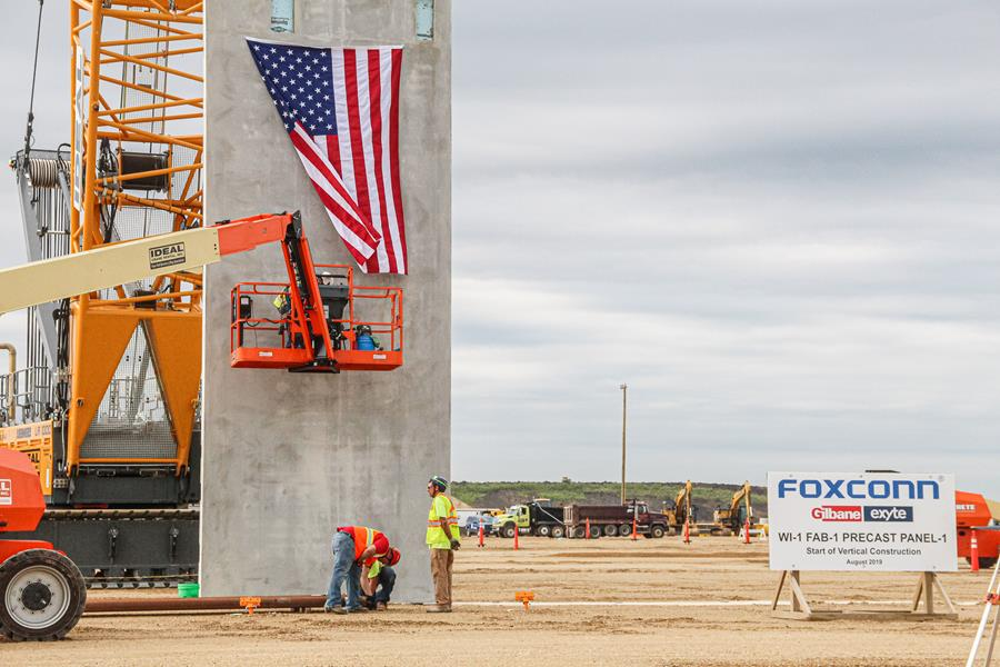 Vertical construction began on Foxconn's Gen 6 Fab building with the installation of the first of more than 400 precast panels, weighing up to 75,000 pounds each. Photo courtesy of Foxconn.