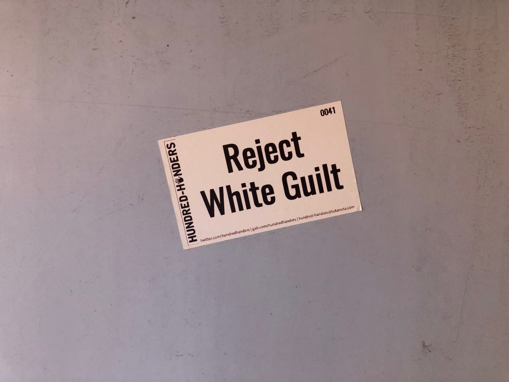 Reject White Guilt sticker. Photo by Jeramey Jannene.