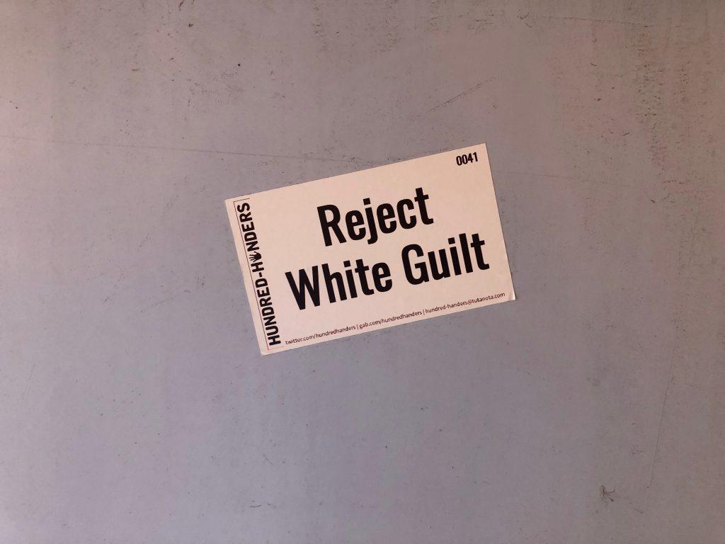 Reject White Guilt sticker. Photo by Jeramey Jannene.