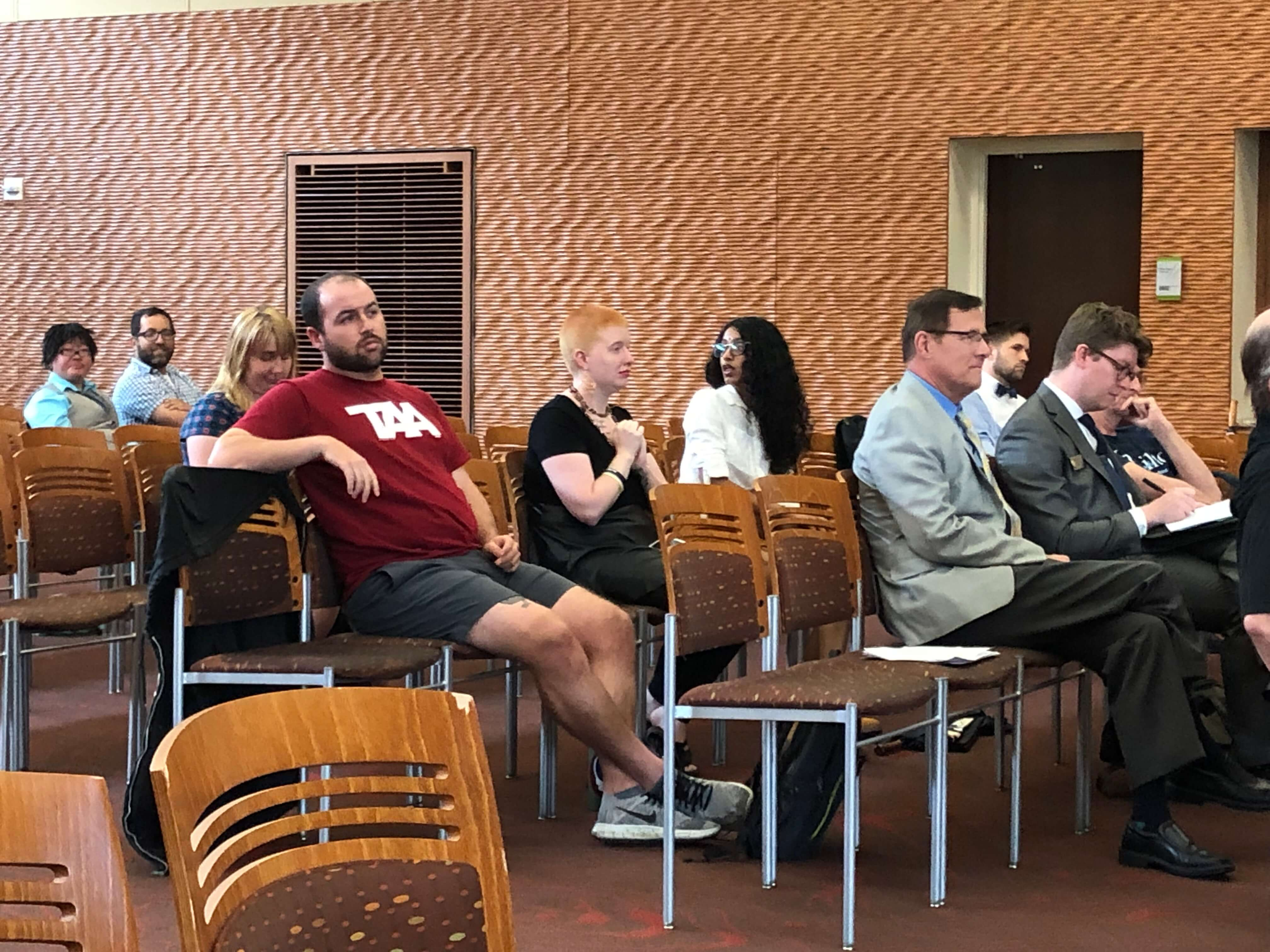 Speakers, including professors and graduate students, wait to address creating a rule that prescribes penalties up to expulsion for students who disrupt campus speakers. Photo courtesy of the Wisconsin Examiner.