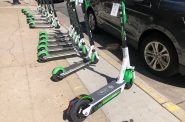 Lime's Gen 3 scooter in front of a row of Gen 2.5 scooters. Photo by Jeramey Jannene.
