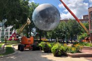 Preparing to raise a replica of the moon in Catalano Square. Photo by Jeramey Jannene.