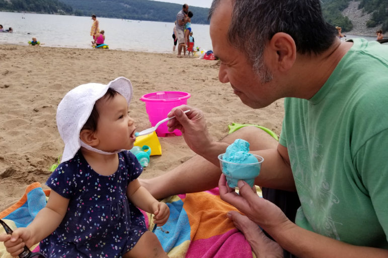 Emma and her father Sothy are seen at Devil's Lake State Park near Baraboo, Wis., in August 2017. The family lived in Wisconsin when Sothy was deported to Cambodia in April 2018 after being charged with possession of marijuana with intent to deliver. He had not lived in Cambodia since he was 2, having come to the United States as a refugee. Photo courtesy of Lisa Kum.