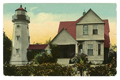 The present lighthouse and keepers quarters opened in 1888. The height of the tower was later increased. Postcard courtesy of the North Point Lighthouse Museum.