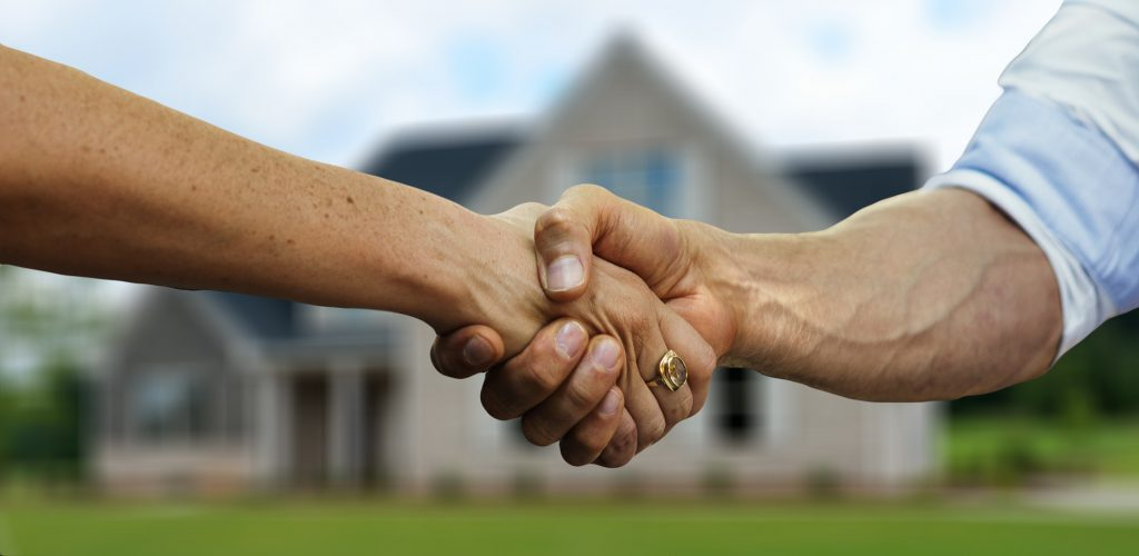 Agreeing to purchase a house.