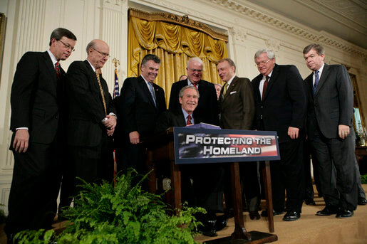 U.S. Rep. Jim Sensenbrenner stands behind President George W. Bush as he signs H.R. 3199, USA Patriot Improvement and Reauthorization Act of 2005 on March 9. White House photo by Eric Draper.