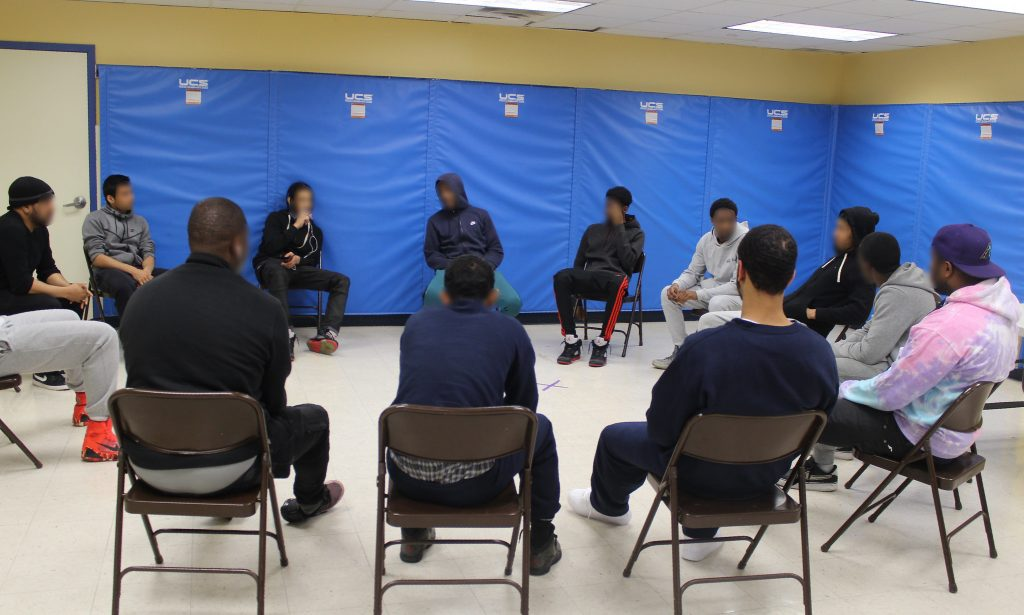 "Young men gather at a community school in the Bronx for a weekly mentoring group as part of their ""aftercare,"" which aims to help them successfully transition back into the community after spending time in a Close to Home facility. Photo by Allison Dikanovic/NNS."