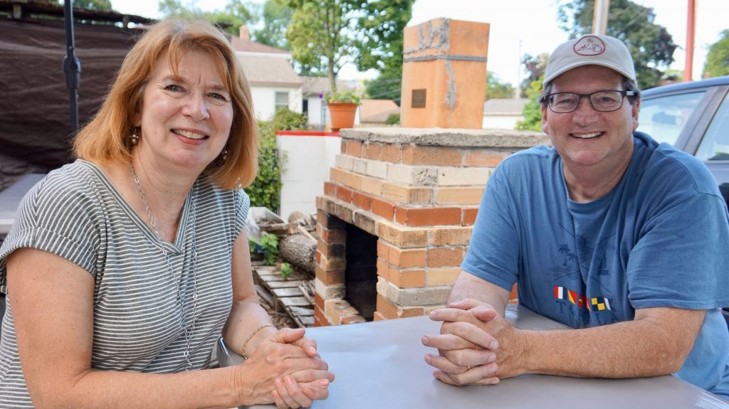 Bob and Pat Olin recently celebrated the 18th anniversary of the launch of their business, the Sherman Perk coffee shop. Neighbors and other customers contributed bricks used to construct the wood-burning fireplace on the shop's patio. Photo by Andrea Waxman/NNS.