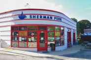 Sherman Perk was originally the Copeland Service Station, opened in 1939. The Olins, who redeveloped it as a coffee shop that opened in 2001, did an extensive environmental cleanup of the site. Photo by Andrea Waxman/NNS.