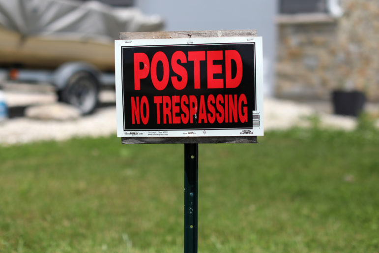 "Kim Mahoney's house on Prairie View Drive in Sturtevant, Wis., has a ""No Trespassing"" sign to discourage looters, whom she said came around after all of the other homes in her subdivision were demolished to make way for the Foxconn manufacturing plant. Photo taken July 1, 2019. Photo by Coburn Dukehart / Wisconsin Watch."