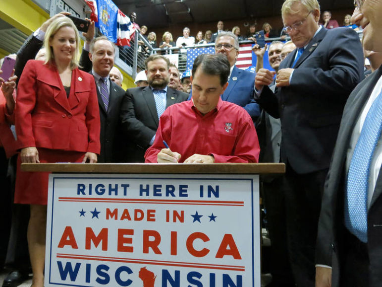 At an event in Sturtevant, Wis., then-Gov. Scott Walker signs the state's largest-ever incentive package into law, a $3 billion-plus bill designed to bring Taiwanese electronics manufacturer Foxconn to Racine County. Photo taken Sept. 19, 2017. Photo by Scott Anderson / Mount Pleasant Patch.