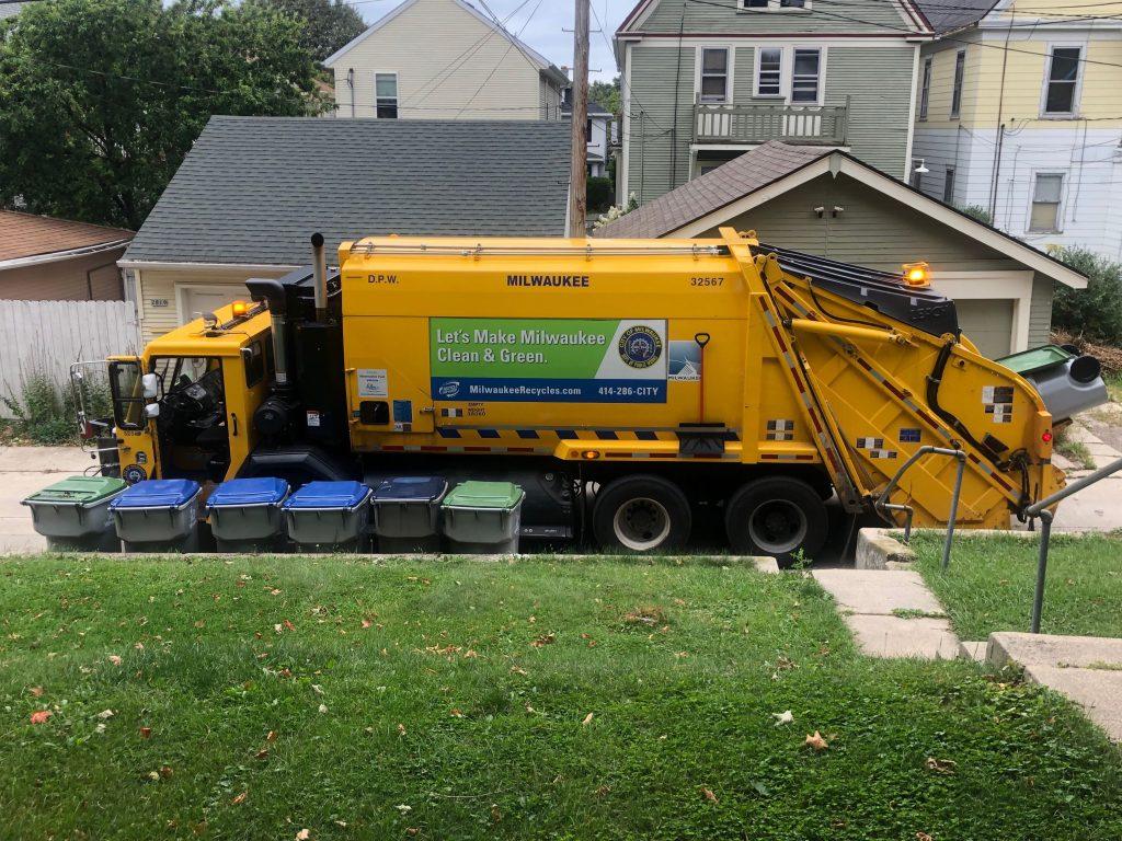 A garbage truck in a Milwaukee alley. Photo by Jeramey Jannene.