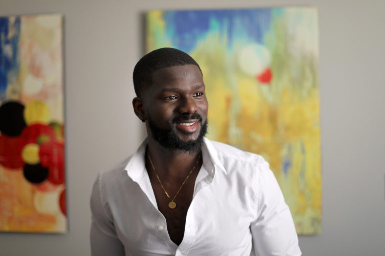 Seun Adedeji owns Elev8 Cannabis, a cannabis brand based in Oregon, and is set to open three dispensaries in Massachusetts. When Adedeji was in middle school, he was arrested for selling cannabis — a fact that will help him in Illinois, which gives advantages to entrepreneurs who have been arrested for cannabis-related offenses. He is seen here in Chicago on Aug. 9, 2019. Photo by Parker Schorr / Wisconsin Watch.