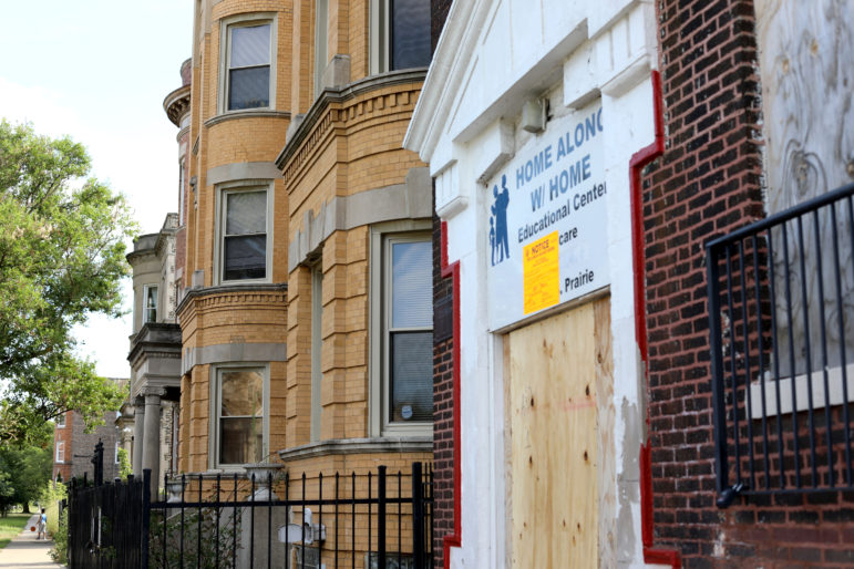Bronzeville, a historically vibrant hub of black culture on the south side of Chicago, has been ravaged by disinvestment and poverty. Here, an educational center in Bronzeville is seen vacant and boarded up on Aug. 9, 2019. Under Illinois' recently signed recreational cannabis law, places like Bronzeville and its residents could find it easier to open cannabis businesses, which some entrepreneurs believe could lead to other forms of economic revitalization. Photo by Parker Schorr/Wisconsin Watch.