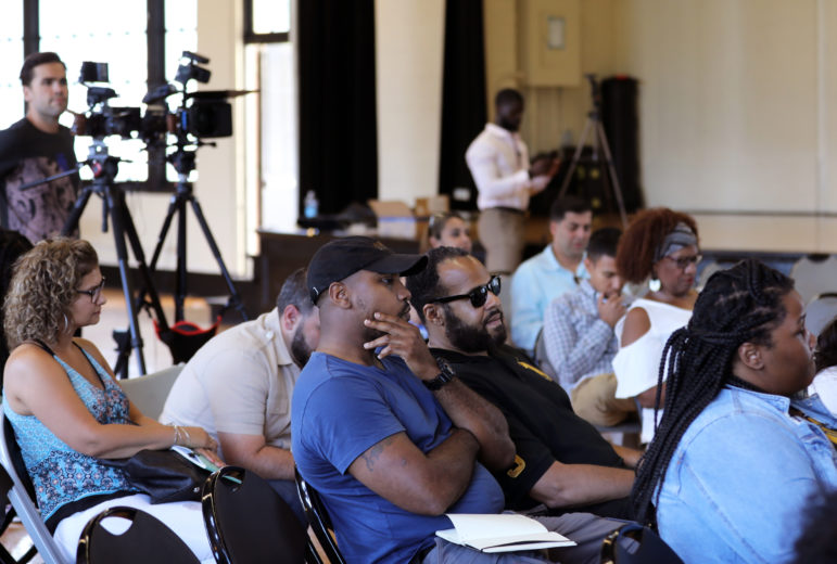 "Attendees wait for a cannabis entrepreneurship event to begin on Aug. 9, 2019, in Chicago. Seke Ballard and Seun Adedeji co-hosted ""Elev8 Our Community: Navigating The Illinois Cannabis Industry"" for Illinois residents, but especially for those who have been harmed by past drug laws and poverty. Under Illinois' recently passed cannabis law, people who have been impacted by enforcement of old marijuana laws will find it easier to participate in the industry. Photo by Parker Schorr / Wisconsin Watch."