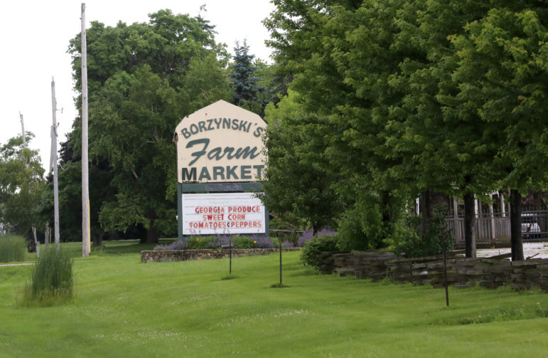 The Borzynski's Farm Market in Mount Pleasant, Wis., sells produce grown in Wisconsin. A federal indictment alleges 14 men from Mexico were forced to work illegally in nearby fields owned by the Borzynskis in 2016. The owners of the farm said in a statement that they had no knowledge of the alleged trafficking. Photo taken July 1, 2019. Photo by Coburn Dukehart / Wisconsin Watch.