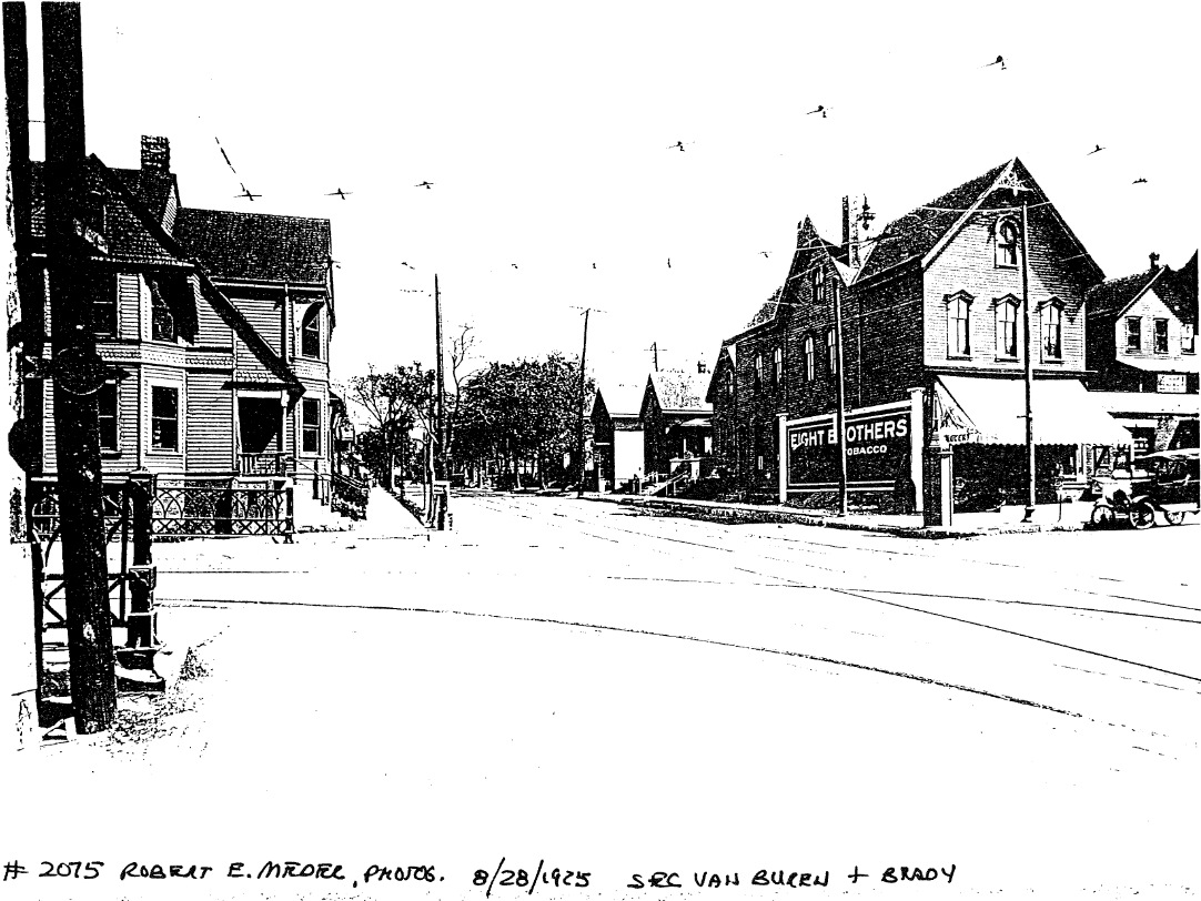 1925 photo of E. Brady St (looking east from Van Buren St.). Building proposed for redevelopment is on the right. Image from city records.