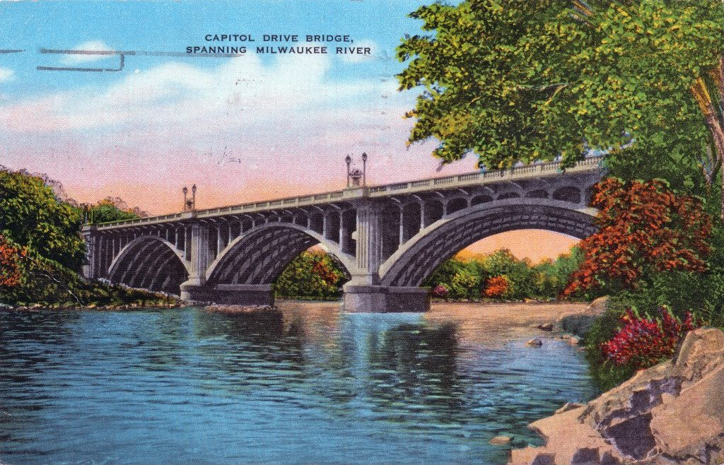 Spanning 532 feet and requiring more than 20,000 tons of concrete, the former Capitol Drive bridge over the Milwaukee River was an imposing structure. The bridge was built in 1927. This postcard was mailed in 1946. Carl Swanson collection
