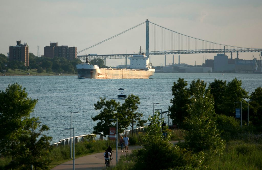 "The Kaministiqua, a 730-foot ocean-faring ship known as a ""salty,"" travels near William G. Milliken State Park and Harbor in Detroit on August 2, 2019. Ocean-going vessels that enter the Great Lakes from the St. Lawrence Seaway are subject to strict ballast water regulations to stem the introduction of invasive species. Those rules do not apply to freighters that stay in the lakes. Photo by Anthony Lanzilote / Bridge Magazine."
