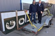 Adam Levin and Jim Witkowiak pose with the Goldmann's sign. Photo from Adam Levin.