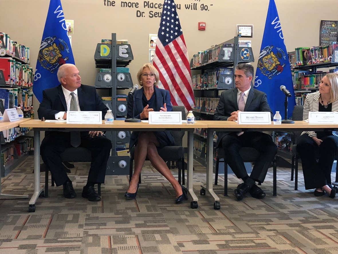 U.S. Secretary of Education Betsy DeVos, second to left, kicks off her back-to-school tour at St. Marcus School in Milwaukee on Sept. 16, 2019. She was joined by, from left to right, state Sen. Scott Fitzgerald, R-Juneau, St. Marcus Lutheran School Superintendent Henry Tyson, and St. Marcus Lutheran School principal Erin Johnson. Corrinne Hess/WPR.