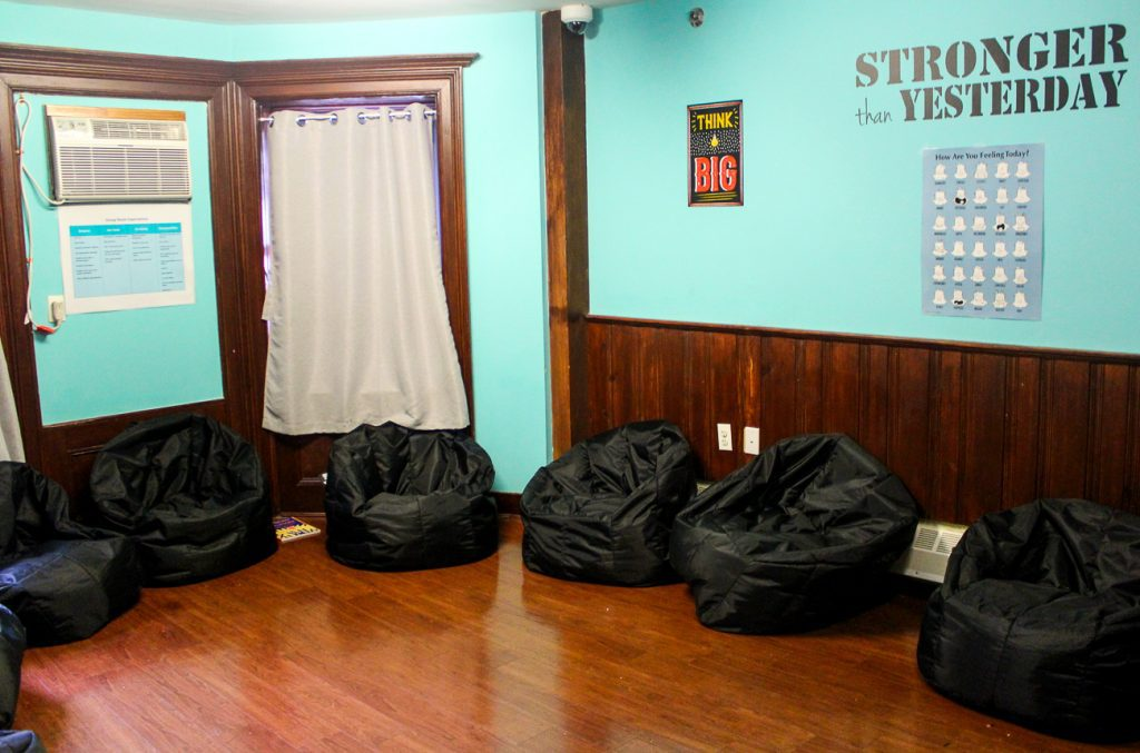 Bean bag chairs line the room where group therapy sessions are held in the Close to Home facility in Brooklyn, New York. Photo by Allison Dikanovic/NNS.