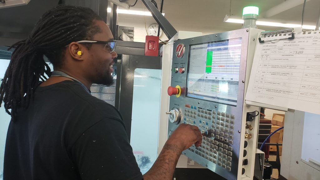 """""""It's not just about the money either. I want an opportunity to grow with the company,"""" said Justin Ashford, 32, who recently completed the Computer Numerical Control training program at MATC. Photo by Edgar Mendez/NNS."""
