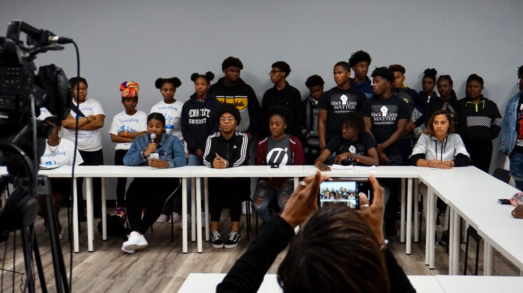 Teens from across the city speak about the toil of gun violence during a forum last week at the Ma'ruf Youth Innovation Center. Photo by Andrea Waxman/NNS.
