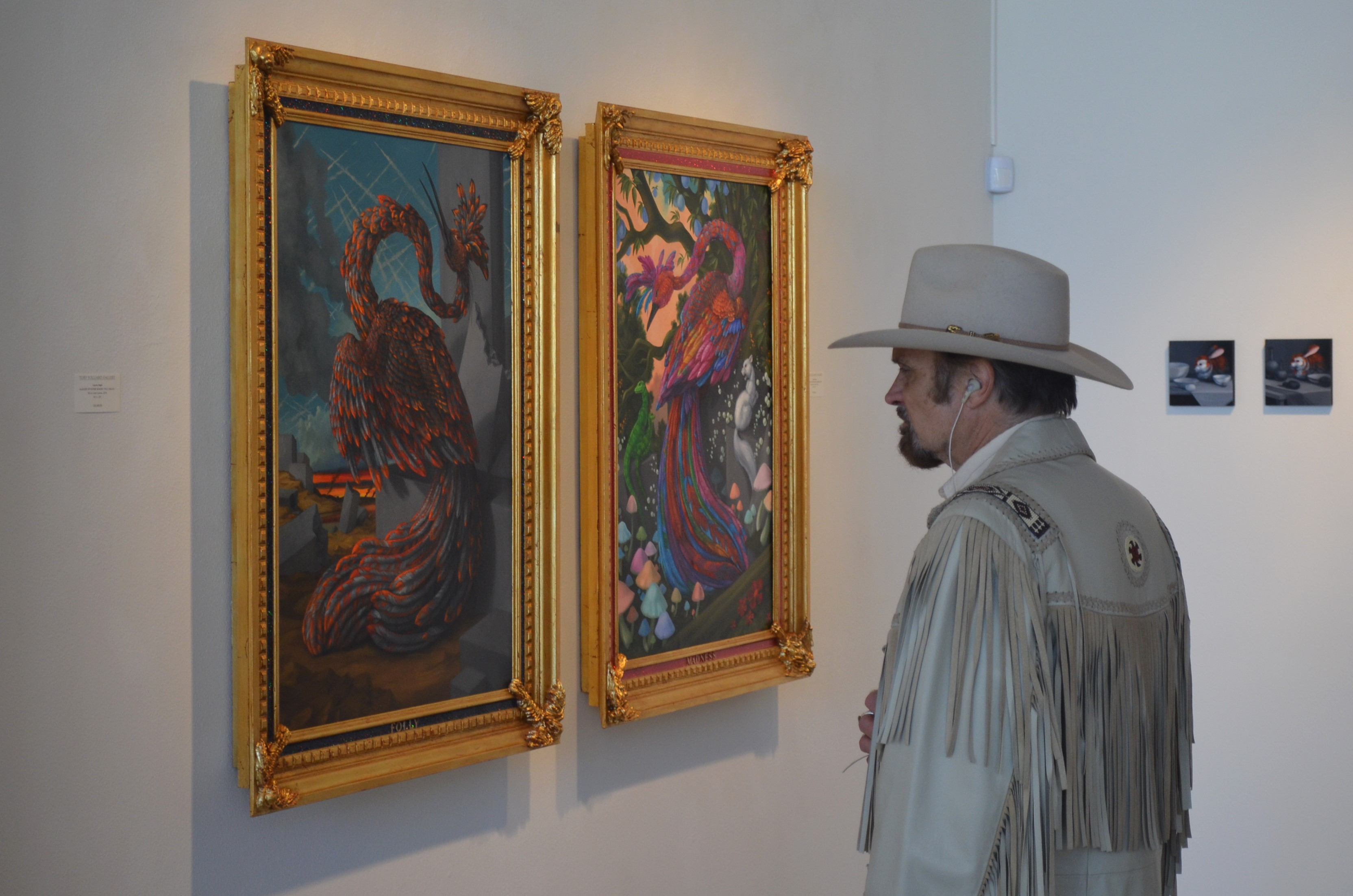 Guest looks at works by Laurie Hogin at Tory Folliard Gallery. Photo by Jack Fennimore.