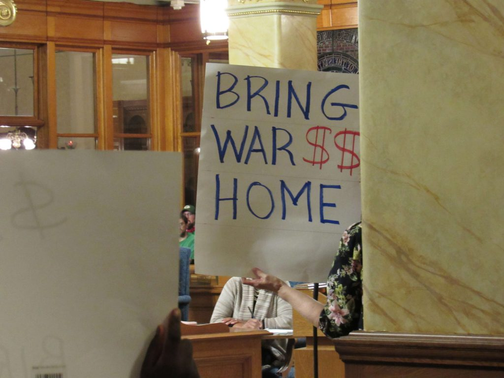 Anti-war activists were present during the meeting. Photo by Isiah Holmes/Wisconsin Examiner.
