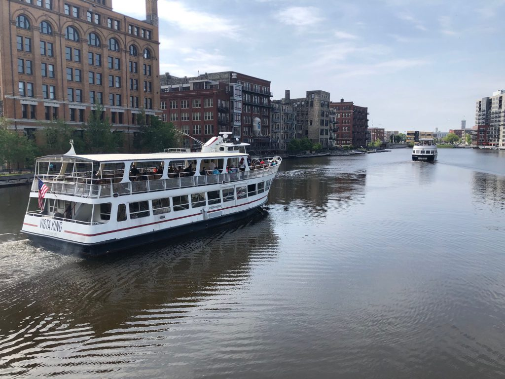 The Vista King and Voyageur boats cruise the Milwaukee River. Photo by Jeramey Jannene.