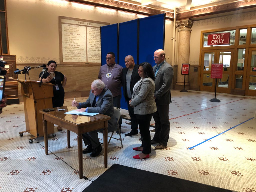 Mayor Barrett signs legislation that makes Indigenous People's Day a holiday in the City of Milwaukee. Photo by Jeramey Jannene.