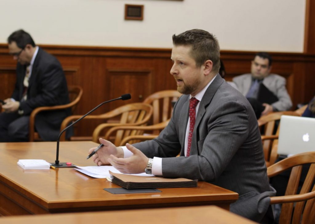 Safe & Just Michigan Executive Director John Cooper is seen on Jan. 30, 2018, testifying before the Michigan House of Representatives' Law and Justice Committee. Cooper opposes fees charged to jail inmates for their incarceration, saying such debts make it difficult for the formerly incarcerated to support themselves and their families. Photo courtesy of Michigan Creative.