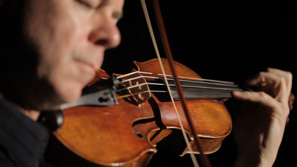 Frank Almond playing the Lipinski Stradivarius violin. Image from Milwaukee Film Festival.