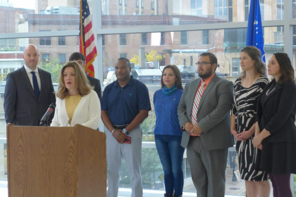 State health and insurance officials announce $500,000 in funding on Tuesday, Oct. 1 for a federally certified group that helps people get health coverage. The money will be used for outreach to sign people up for Medicaid and also private insurance sold on the federal marketplace, which opens Nov. 1. Photo by Shamane Mills/WPR.