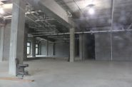 An empty, unfinished, office space is the site for a planned Foxconn innovation center at Haymarket Landing in downtown Eau Claire. In July 2018 Foxconn officials and former Gov. Scott Walker announced the company would create 150 jobs in the city. Photo by Rich Kremer/WPR.