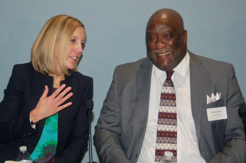The Rev. Willie Brisco, then-president of WISDOM and MICAH, and Dr. Anne Bonds, UWM professor of geography and urban studies, speak on a panel about race in November 2016. File photo by Naomi Waxman/NNS.