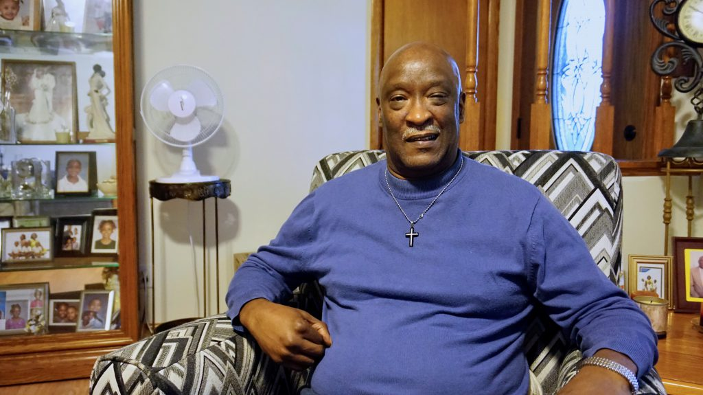 """The Rev. Willie Brisco talks about his journey to activism in his home in the Bradley Estates neighborhood on the Northwest Side. """"Everything that I have lived is God's divine plan for creating in me the activist that I am,"""" he says """"And along the way, he has shown me what I was supposed to do."""" Photo by Andrea Waxman/NNS."""
