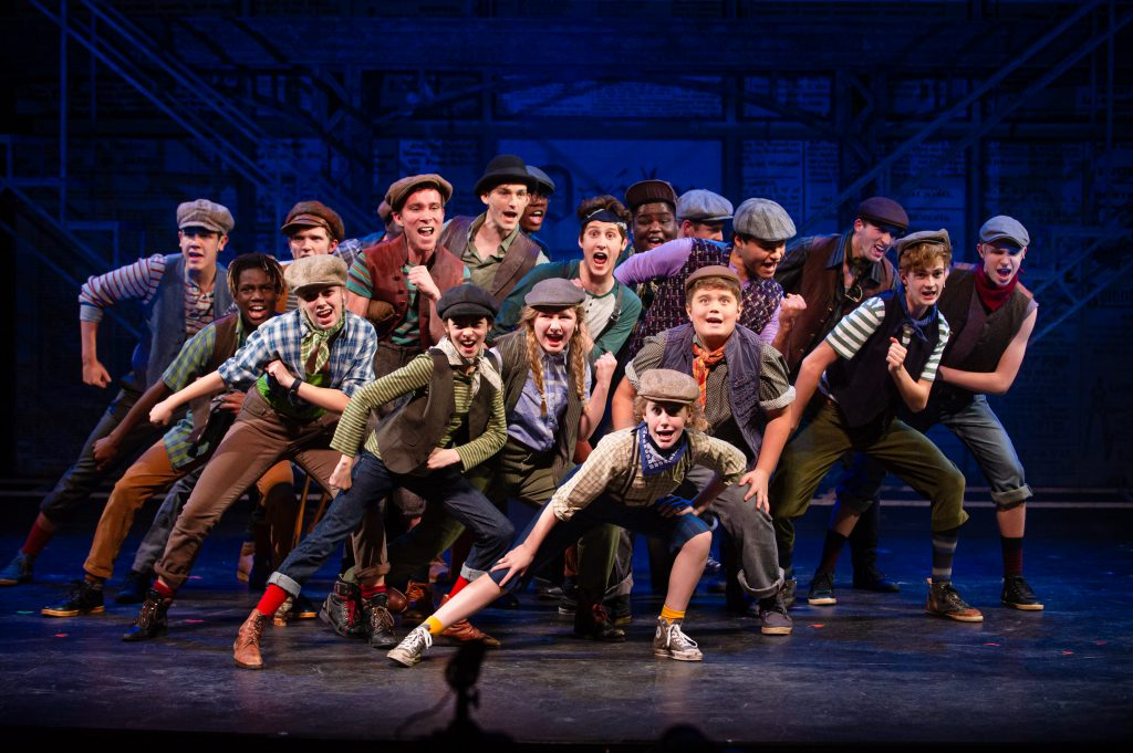 The cast of Skylight Music Theatre's production of Disney's Newsies running November 15 – December 29, 2019. Photo by Mark Frohna.