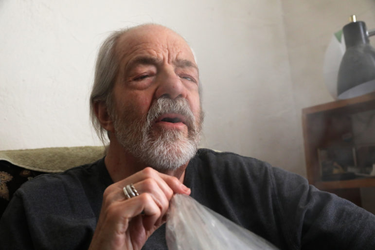 Madison resident Gary Storck has suffered from glaucoma since childhood and has been using marijuana to alleviate the symptoms since he was a teenager. He also uses it to help with a number of other health conditions, including as a homemade treatment for prostate cancer. Storck says he normally uses marijuana as medicine every two to three hours. Here he inhales vapor containing heated marijuana in his apartment in Madison, Wis., March 20. Photo by Coburn Dukehart / Wisconsin Watch.