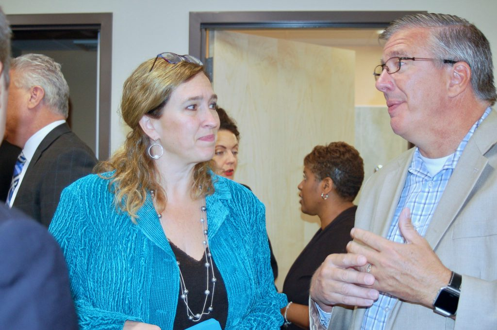 Dr. Julie Schuller, the president and CEO of Sixteenth Street Community Health Center, talks with state Rep. John Nygren (right) at the grand opening of the Layton Clinic in May 2018. File photo by Andrea Waxman/NNS.