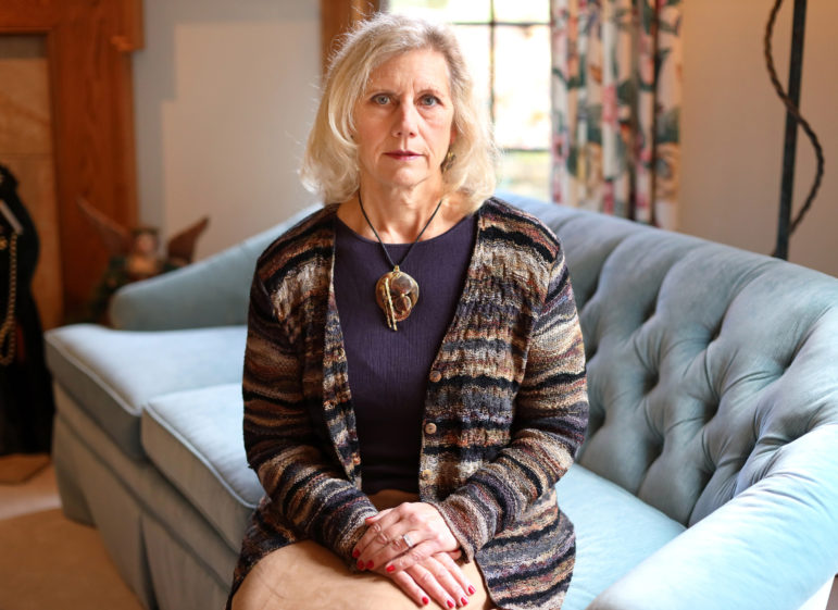 "Dr. Kathy Hartke, a retired obstetrician and gynecologist and former chairwoman of the Wisconsin section of the American College of Obstetricians and Gynecologists, recalls an incident she described as a ""possible time bomb"" in which Catholic directives required her to delay care to a woman who went into premature labor with twins. She is seen at her home in Brookfield, Wis. Photo by Coburn Dukehart / Wisconsin Watch."