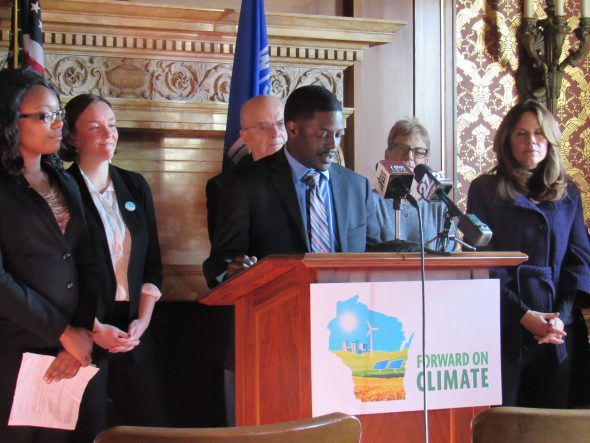 Rep. David Crowley and Rep. Chris Taylor helping announce the package of climate-related bills. Photo by Isiah Holmes/Wisconsin Examiner.