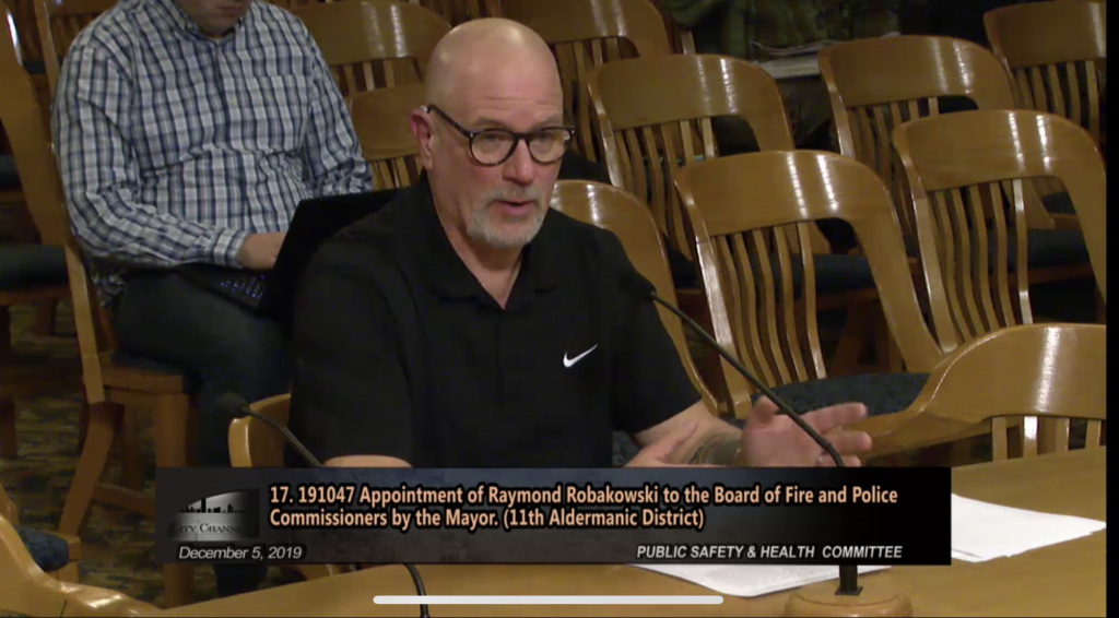 Raymond Robakowski speaks before the Public Safety and Health Committee. Image from the City of Milwaukee.