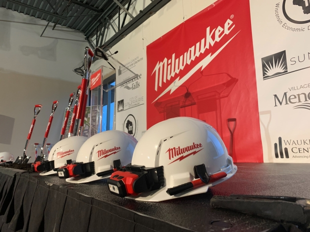 Hard hats and shovels are lined up at a groundbreaking event for Milwaukee Tool's new facility in Menomonee Falls. Photo by Alana Watson/WPR.