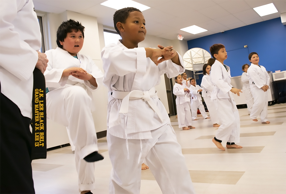 Students practice taekwondo forms, led by freshman Yanelly Lopez in the cafeteria of Seeds of Health Elementary School in Milwaukee. Photo by Liz Dohms/WPR.