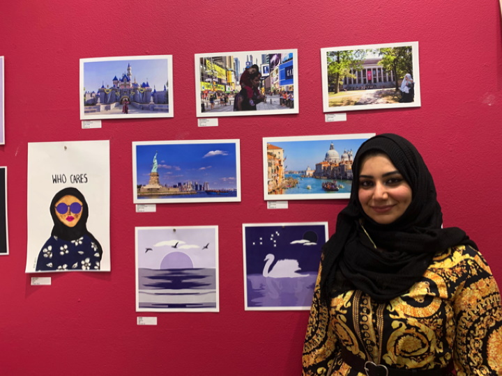 Nada Alzalloum, 27, an immigrant from Jordan, stands in front of her digitally created images. Photo by Claudia Delgadillo/NNS.
